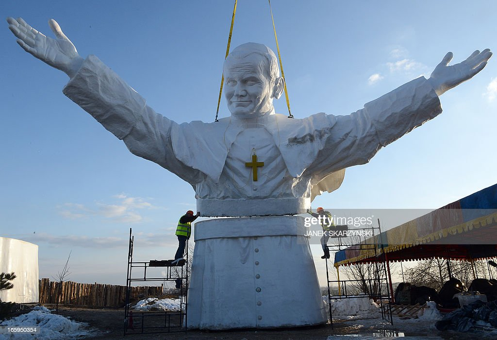 Workers put together elements of a 13,8m tall sculpture of late Pope John Paul II in Czestochowa, southern Poland on April 7, 2013. AFP PHOTO/JANEK SKARZYNSKI
