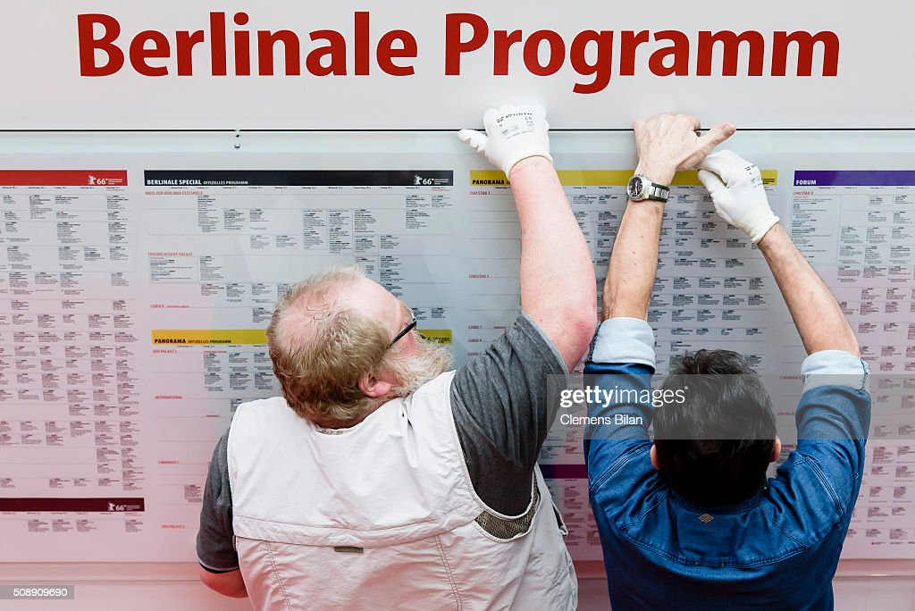 Workers put up a Berlinale program schedule near the Festival site prior to the 66th Berlinale on February 7, 2016 in Berlin, Germany.