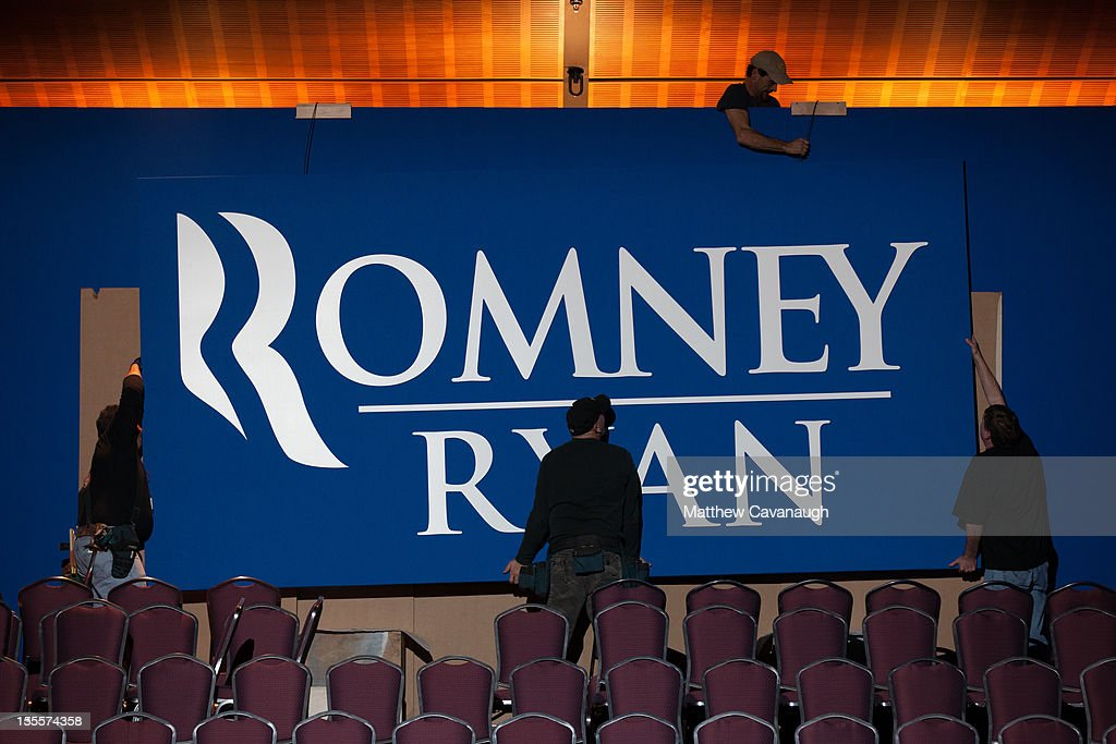 Workers put up signs for U.S. Republican presidential candidate, former Massachusetts Governor Mitt Romney's election night event, on November 5, 2012 in Boston, Massachusetts. National polls show that Romney and U.S. President Barack Obama are in a virtual dead heat in the race for the presidential election on Tuesday.