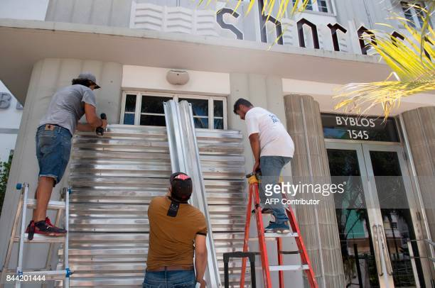 Workers put up storm shutters in preparation of Hurricane Irma in Miami Beach Florida September 8 2017 Florida Governor Rick Scott warned that all of...