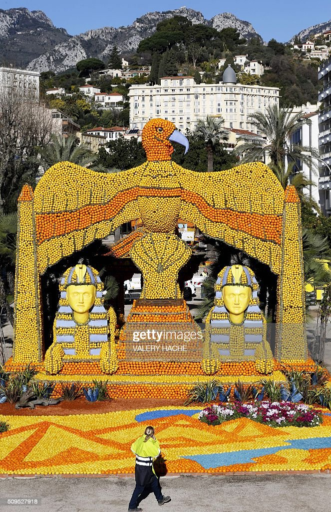 A workers puts the final touch on a sculpture decorated with oranges and lemons in Menton on the French Riviera on February 11, 2016, ahead of the start of the 'Fete du Citron' (Lemon Festival). The theme of this 83rd edition, running from February 13 until March 2, 2016, is called 'Cinecitta'. / AFP / VALERY HACHE