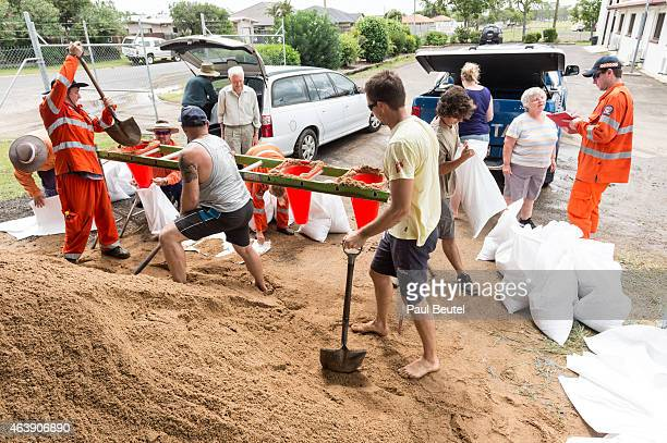 SES workers race to fill sand bags as residents prepare to defend their homes as Cyclone Marcia approaches the Central Queensland on February 20 2015...