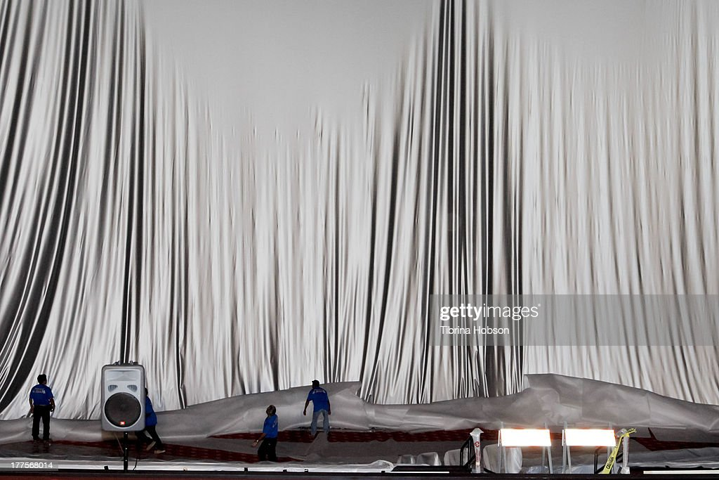 Workers raise the world's largest IMAX screen at TCL Chinese Theatre on August 23, 2013 in Hollywood, California.