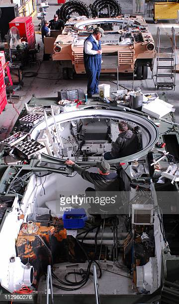 Workers ready an M1A1 for a new engine at the Anniston Army Depot in Anniston Alabama on Tuesday December 5 2006