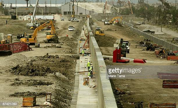Workers rebuild the levee which was breached by Hurricane Katrina along the Industrial Canal in the Lower Ninth Ward April 25 2006 in New Orleans...
