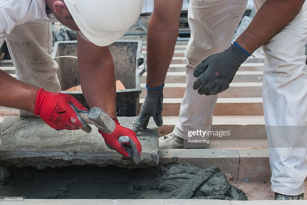 Workers refine a stone of the stairs during the renovation of the Rialto Bridge on May 26, 2016 in Venice, Italy. Site visits were organized to see the renovation of the Rialto bridge to coincide with the 15th Biennale of Architecture in Venice.