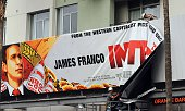 Workers remove a poster for 'The Interview' from a billboard in Hollywood California December 18 2014 a day after Sony announced it had no choice but...