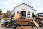 Workers remove debris from Monte Calvario church after it was flood damaged by Hurricane Ike September 21 2008 in Galveston Texas Although much of...