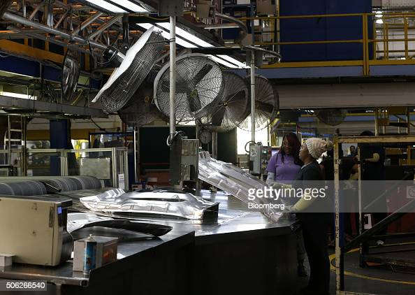 Workers remove inner hood parts for the Ram 1500 from an older transfer press at Fiat Chrysler Automobiles NV's Warren Stamping Plant in Warren...