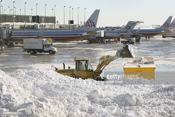 Workers remove snow from a runway at O'Hare International Airport February 3 2011 in Chicago Illinois Commercial carriers at the airport started...