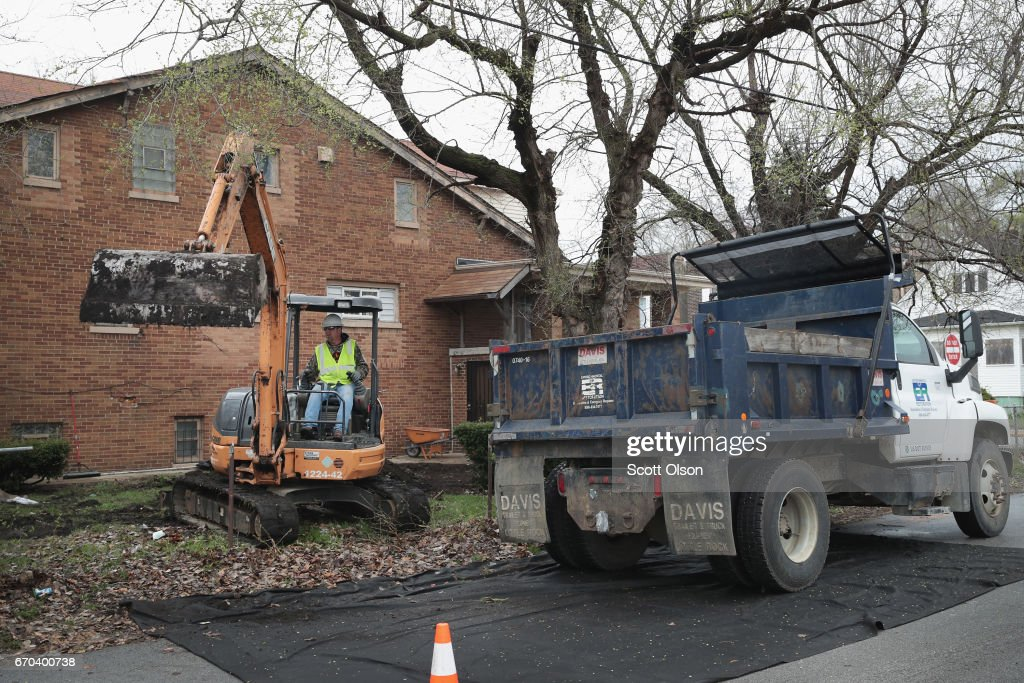 Workers remove topsoil from the yard of a home near the Carrie Gosch Elementary School where U.S. EPA Administrator Scott Pruitt was meeting with area residents and community leaders on April 19, 2017 in East Chicago, Indiana. Gosch school was closed after high levels of lead and arsenic were found in the West Calumet Housing Complex which borders the school. The area has been declared an EPA superfund site. This was Pruitt's first visit to a superfund site since being named the agency's administrator. The EPA is continuing remediation efforts at homes near the school and housing complex. The housing complex is scheduled for demolition.