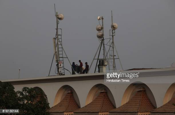 Workers removes mobile tower at Sahyadri Guest House at Malabar hill on Tuesday