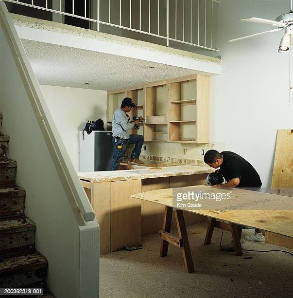 Workers renovating apartment