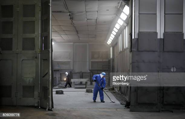 Workers repair an area for cleaning pipelines at the Automatic Coating Ltd facility in Toronto Ontario Canada on Wednesday Jan 11 2017 Statistics...