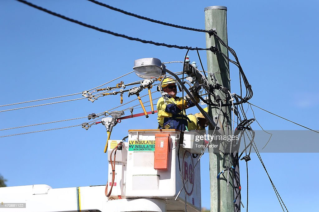 Workers repair power lines at Kincumber on the Central Coast on April 24, 2015 in Gosford, Australia. Gosford City and Wyong shire have official been declared disaster zones, due to the damage caused by the worst storms to hit the region in decades.