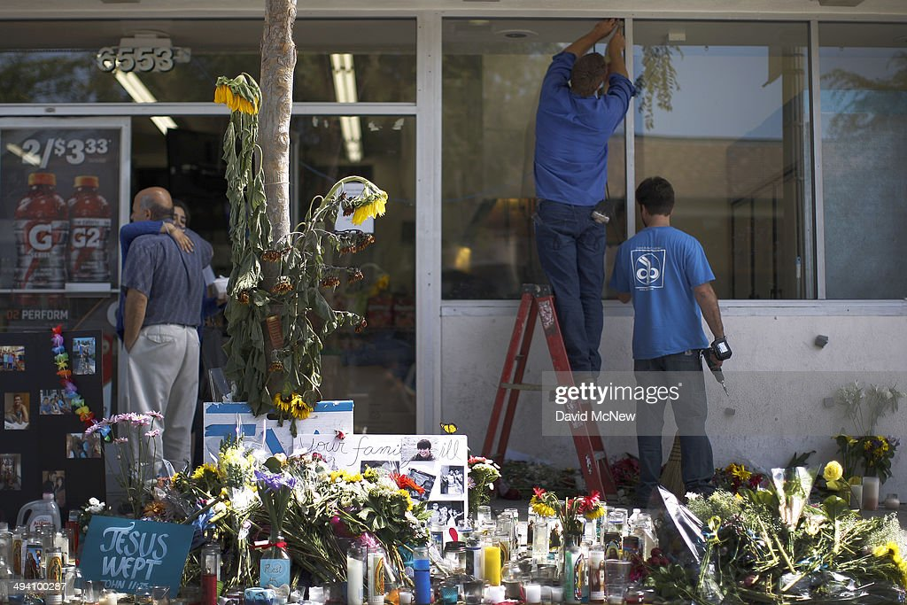 Workers replace a bullet-riddled window near a makeshift memorial at the IV Deli Mart on the Day of Mourning and Reflection for the victims of a killing spree at University of California, Santa Barbara on May 27, 2014 in Isla Vista, California. Elliot Rodger killed six college students at the start of Memorial Day weekend and wounded seven other people, stabbing three then shooting and running people down in his BMW near UCSB before shooting himself in the head as he drove. Police officers found three legally-purchased guns registered to him inside the vehicle. Prior to the murders, Rodger posted YouTube videos declaring his intention to annihilate the girls who rejected him sexually and others in retaliation for his remaining a virgin at age 22.