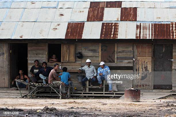 Workers rest at their camp in the PT Exploitasi Energi Indonesia open pit coal mine in Palaran East Kalimantan province Indonesia on Friday Sept 13...