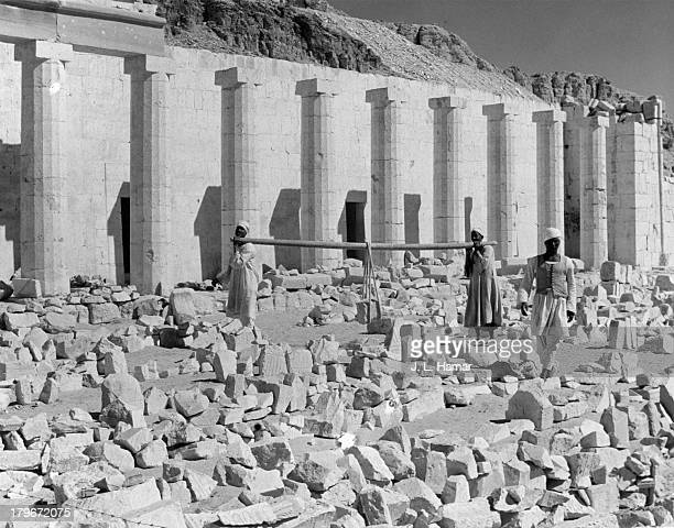 Workers restore the The Mortuary Temple of Queen Hatshepsut in Deir el Bahari Egypt