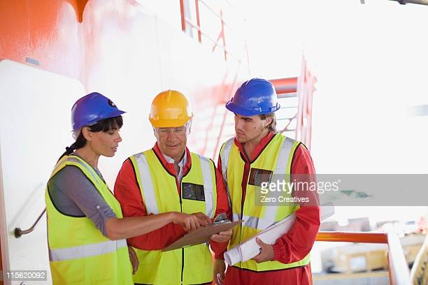Workers reviewing the following scedule