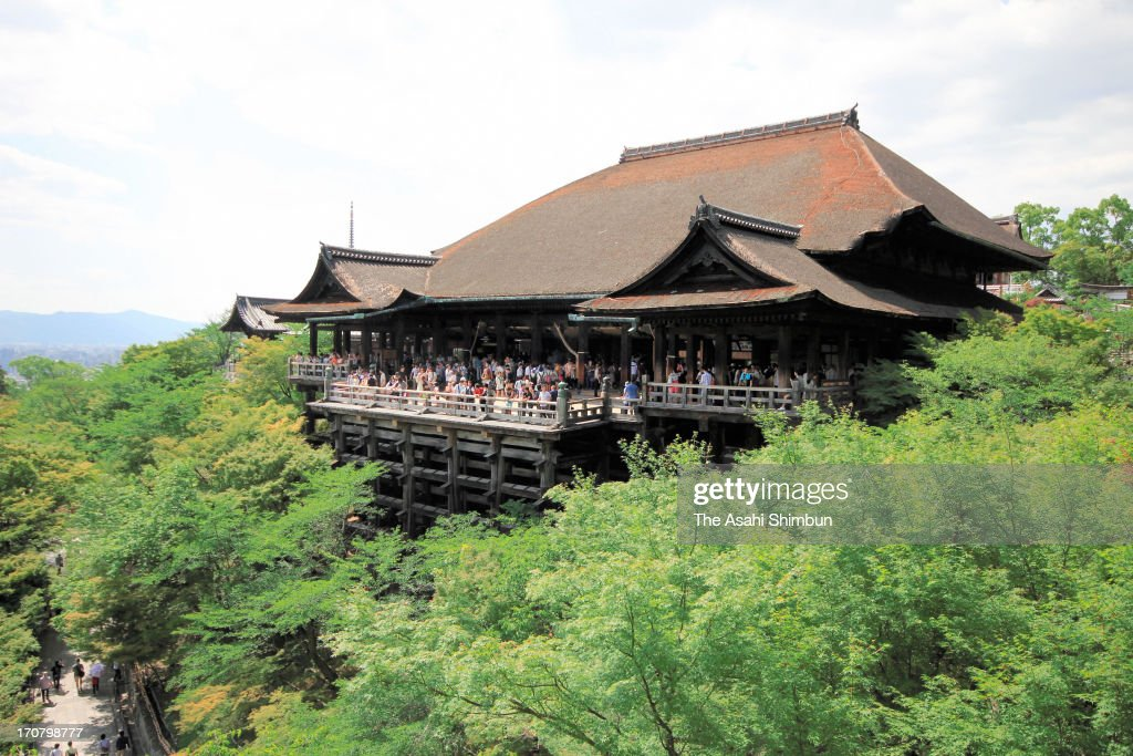 Workers scaffold to the columns of the stage of Kiyomizudera Temple on June 16, 2013 in Kyoto, Japan. The work to replace the decayed parts of nine columns will start in mid July.