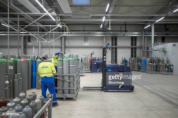 Workers scan empty canisters inside the Linde AG compressed gas plant in Marl Germany on Monday Nov 20 2017 Linde won enough shareholder support to...