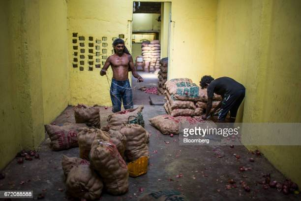 Workers seal sacks in an onion warehouse in the Pettah neighborhood of Colombo Sri Lanka on Thursday April 20 2017 The Central Bank of Sri Lanka is...
