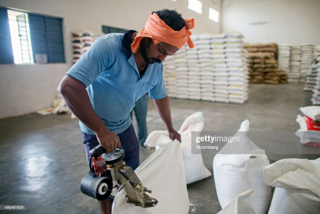 A workers seals a bags of rice at the KRK Modern Rice Mill in Kothapeta, Tamil Nadu, India, on Thursday, Nov. 14, 2013. Record onion prices and the soaring cost of rice and coriander are frustrating Reserve Bank of India Governor Raghuram Rajans battle to curb inflation while supporting growth in Asias third-largest economy. Photographer: Prashanth Vishwanathan/Bloomberg via Getty Images