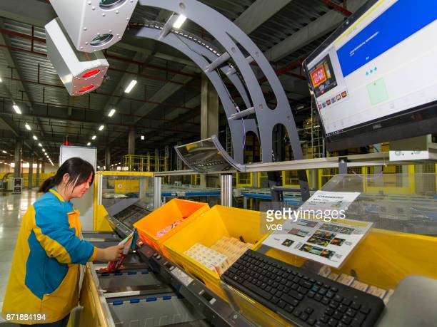 Workers select packages at the intelligent warehouse 'Suning cloud warehouse' of China's retail giant Suning on November 8 2017 in Nanjing Jiangsu...