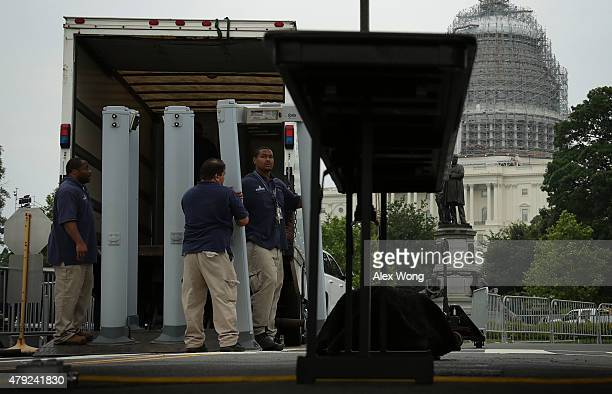 Workers set up a security checkpoint for the Capitol Fourth concert at the west front of the US Capitol July 2 2015 in Washington DC Security has...