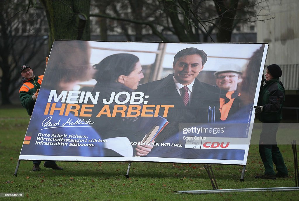 Workers set up an election campaign billboard featuring Lower Saxony Governor and incumbent candidate of the German Christian Democrats (CDU) David McAllister on January 5, 2013 in Hanover, Germany. Lower Saxony is holding state elections on January 20 and many analysts see the election as a bellwether for national elections scheduled to take place later this year.