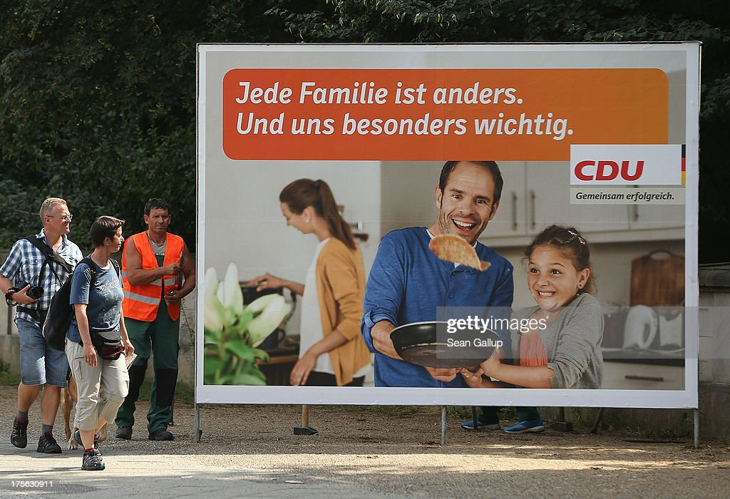 Workers set up an election campaign poster of the German Christian Democrats (CDU) that reads: 'Every family is different. And especially important to us.' on August 6, 2013 in Berlin, Germany. Germany is scheduled to hold federal elections on September 22 and so far current Chancellor Angela Merkel and her party, the German Christian Democrats (CDU), have a strong lead over the opposition.