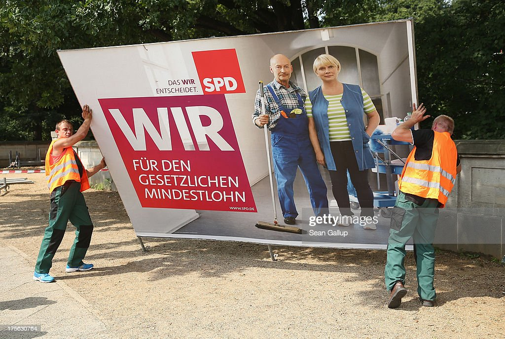 Workers set up an election campaign poster of the German Social Democrats (SPD) in the city center on August 6, 2013 in Berlin, Germany. Germany is scheduled to hold federal elections on September 22 and so far current Chancellor Angela Merkel and her party, the German Christian Democrats (CDU), have a strong lead over the opposition.