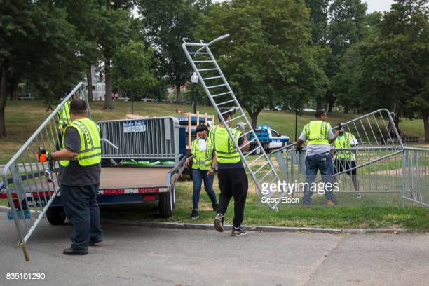 Workers set up barricades on the Boston Common where a 'Free Speech' rally is scheduled and a large rally against hate In solidarity with victims of...