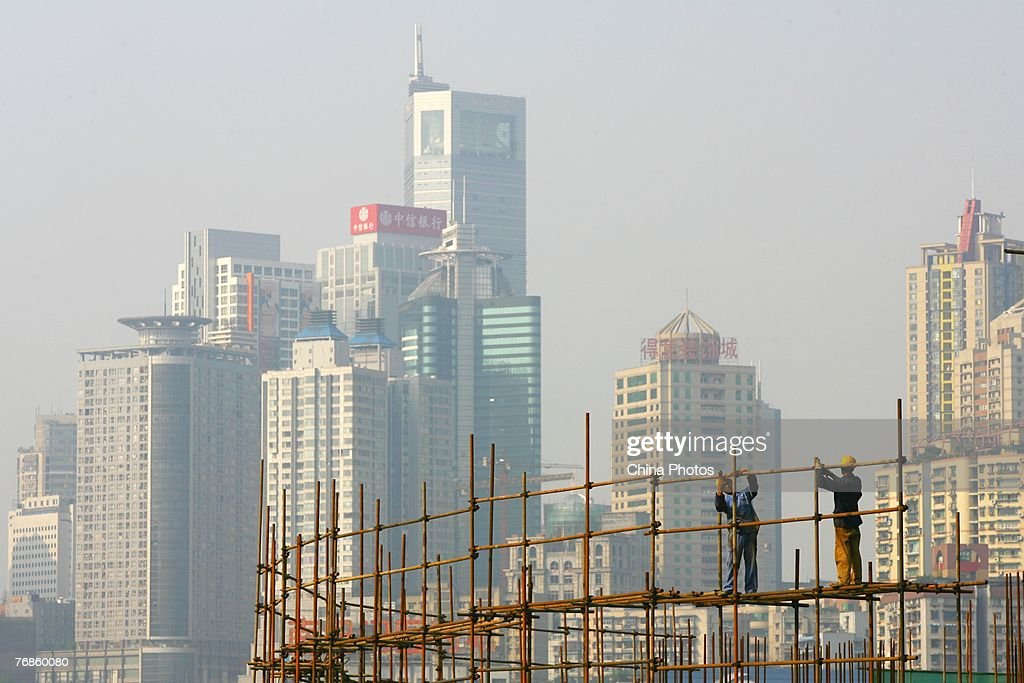 Workers set up scaffolding at a construction site on September 19, 2007 in Chongqing Municipality, China. China's property investment rose 29 per cent, up from the same period last year to 1.43 trillion yuan (about US$189.9 billion) in the first eight months this year, with the majority going towards commercial housing.
