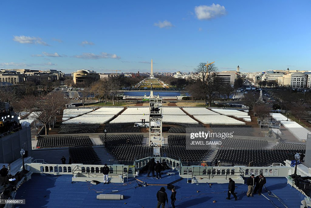 Workers set up the main stage at the US Capitol as preparations continue for the second inauguration of US President Barack Obama in Washington on January 18, 2013. Crowds may be smaller on the January 21 inauguration than when Barack Obama was first sworn into office in 2009, but security is as tight as ever, with experts warning a 'lone wolf' would pose the greatest threat. Between 500,000 and 800,000 people are expected to pass through the National Mall, the immense greenway that leads up to the Capitol, compared to the 1.8 million spectators who came to applaud Obama four years ago. AFP PHOTO/Jewel Samad
