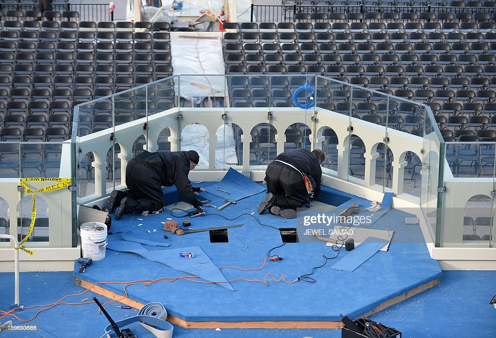 Workers set up the main stage at the US Capitol as preparations continue for the second inauguration of US President Barack Obama in Washington on January 18, 2013. Crowds may be smaller at the January 21 inauguration than when Barack Obama was first sworn into office in 2009, but security is as tight as ever, with experts warning a 'lone wolf' would pose the greatest threat. Between 500,000 and 800,000 people are expected to pass through the National Mall, the immense greenway that leads up to the Capitol, compared to the 1.8 million spectators who came to applaud Obama four years ago. AFP PHOTO/Jewel Samad
