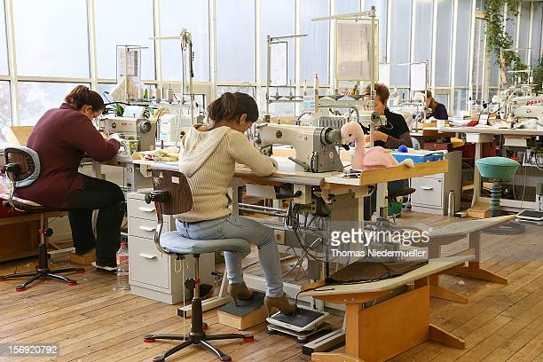 Workers sew at the Steiff stuffed toy factory on November 23 2012 in Giengen an der Brenz Germany Founded by seamstress Margarethe Steiff in 1880...