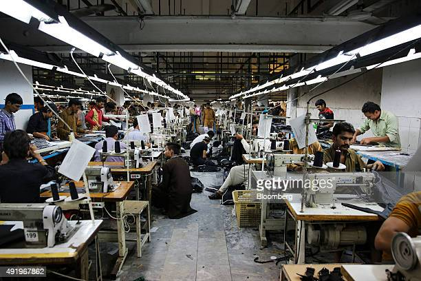 Workers sew men's leather jackets at a Leather Filed Pvt factory in Sialkot Pakistan on Oct 2 2015 The South Asian nation's consumer price gains will...
