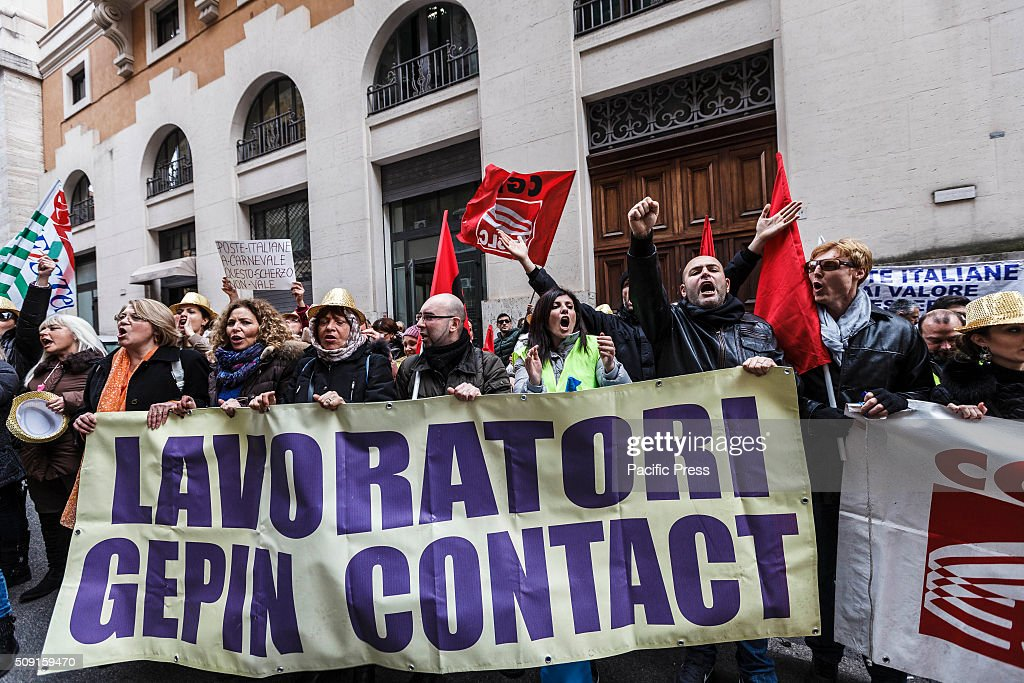 Workers shout slogans, wave flags and hold banners as they take a rally to protest against dismissal of 450 workers. A group of call center employees of Gepin (former Poste Italiane) hold a rally in Rome, in front of the Ministry of Economic Development, to protest against layoffs.