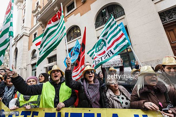 Workers shout slogans wave flags and hold banners as they take a rally to protest against dismissal of 450 workers A group of call center employees...