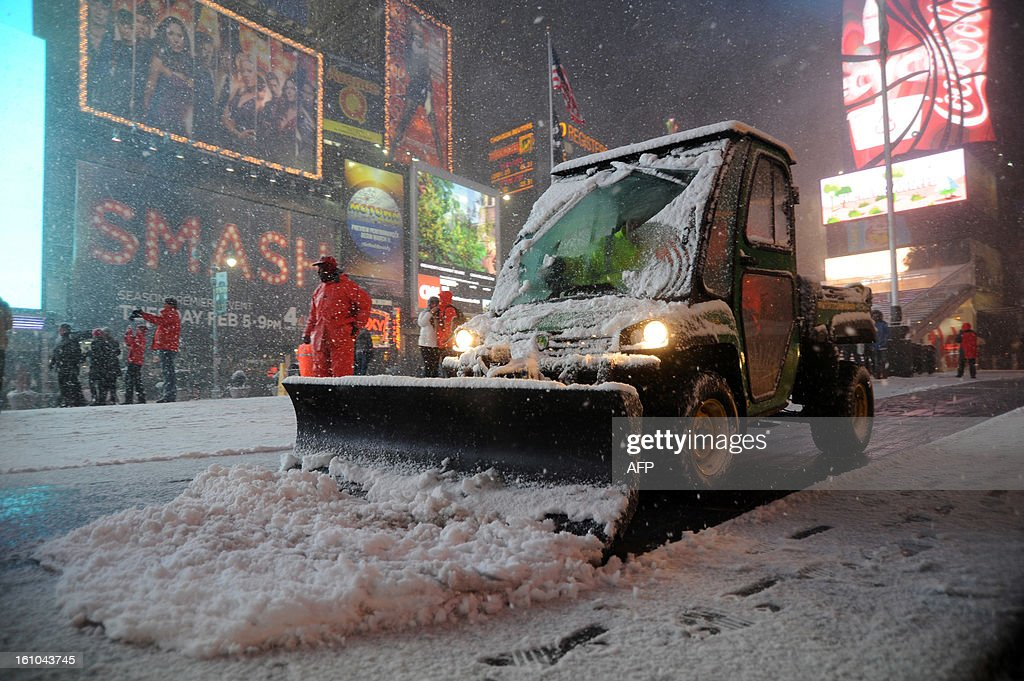 Workers shovel snow in Times Square in New York on February 8, 2013 during a storm affecting the northeast US. The storm was forecast to bring the heaviest snow to the densely-populated northeast corridor so far this winter, threatening power and transport links for tens of millions of people and the major cities of Boston and New York. New York and other regional airports saw more than 4,500 cancellations ahead of what the National Weather Service called 'a major winter storm with blizzard conditions' along most of the region's coastline. AFP PHOTO / MEHDI TAAMALLAH