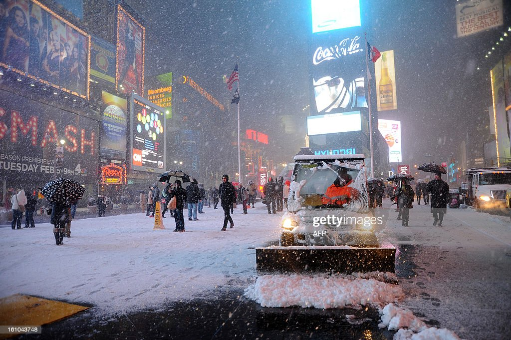 Workers shovel snow in Times Square in New York on February 8, 2013 during a storm affecting the northeast US. The storm was forecast to bring the heaviest snow to the densely-populated northeast corridor so far this winter, threatening power and transport links for tens of millions of people and the major cities of Boston and New York. New York and other regional airports saw more than 4,500 cancellations ahead of what the National Weather Service called 'a major winter storm with blizzard conditions' along most of the region's coastline.