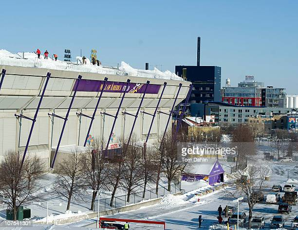 Workers shovel snow off of the Hubert H Humphrey Metrodome Mall of America Stadium where the inflatable roof collapsed under the weight of snow...
