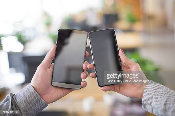 IT workers showing smart phone in office