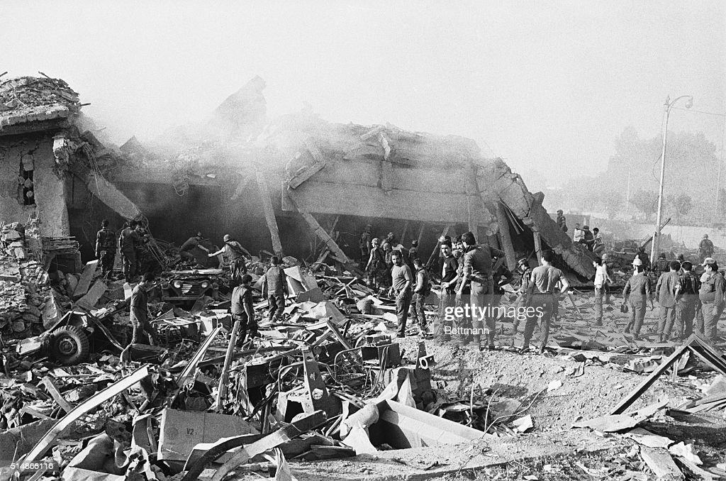 Workers sift through the rubble of a US marine barracks in Beirut Lebanon which collapsed after a truck filled with explosives crashed through a gate...