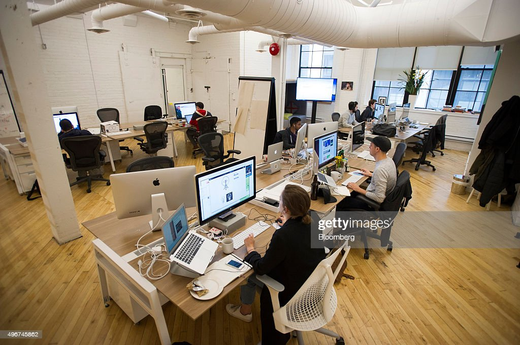 software company office. workers sit at their desks in the shopify inc offices companyu0027s headquarters software company office