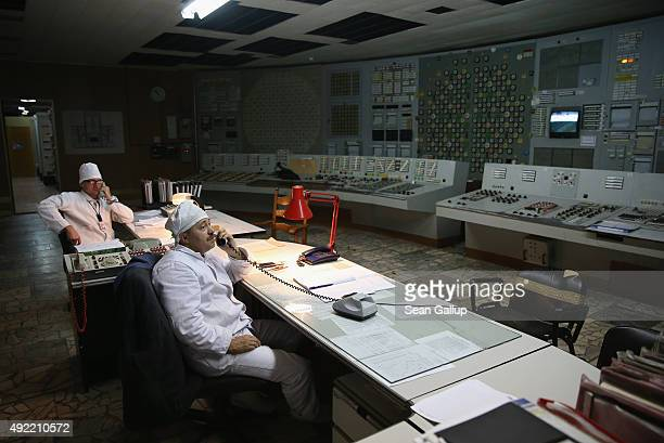 Workers sit in the control room of reactor number two inside the former Chernobyl nuclear power plant on September 29 2015 near Chornobyl Ukraine The...