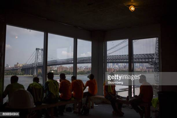 Workers sit inside the 416 Kent Avenue apartment development during construction in the Williamsburg neighborhood of the Brooklyn borough of New York...