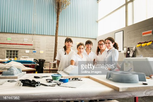 Workers smiling in manufacturing plant : Stock Photo