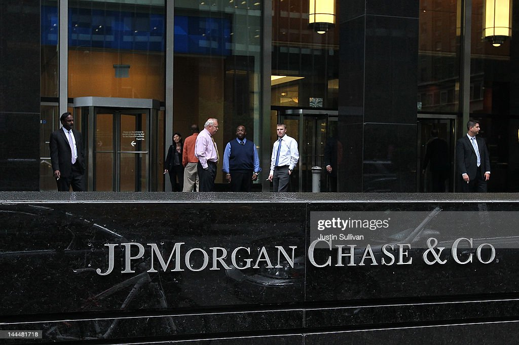 Workers smoke cigarettes outside of a JPMorgan Chase office on May 14 2012 in New York City Following a $2 billion trading blunder JPMorgan Chase's...